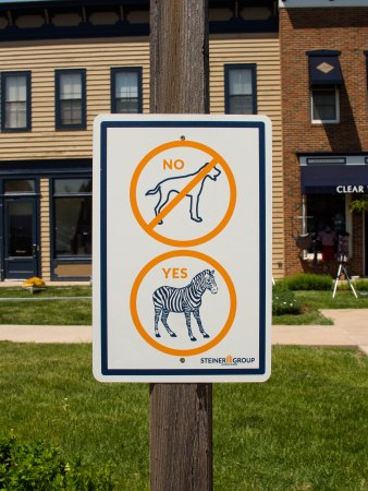 Photograph of a sign: No dogs, Yes zebras